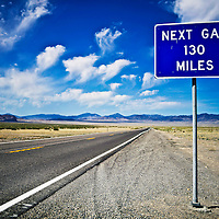 A sign on US highway 93A informs motorists of the next gas station in Nevada. The route follows the old Lincoln Highway route down and allows travelers to detour to Skull Valley and take the original route into Ely. <br /> <br /> <br /> /// ADDITIONAL INFORMATION: 5/26/11 - 34travel.Lincoln.East.0929 .sp - STUART PALLEY Lincoln Highway West