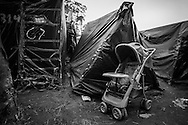 A baby kart outside one of the tents where lives a family in Copa do Povo (People's Cup) Camp in Itaquera, São Paulo. The Copa do Povo Camp, is just a few miles from the Arena Corinthians and has 5,000 homeless workers and their families occupied area of fifteen acres. They are homeless after rents skyrocketed because of the World Cup. (Eduardo Leal).
