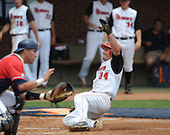 St. John's Jimmy Brennan (24) scores behind Mississippi's Miles Hamblin (24) in the first inning during an NCAA Regional game at Davenport Field in Charlottesville, Va. on Sunday, June 6, 2010.
