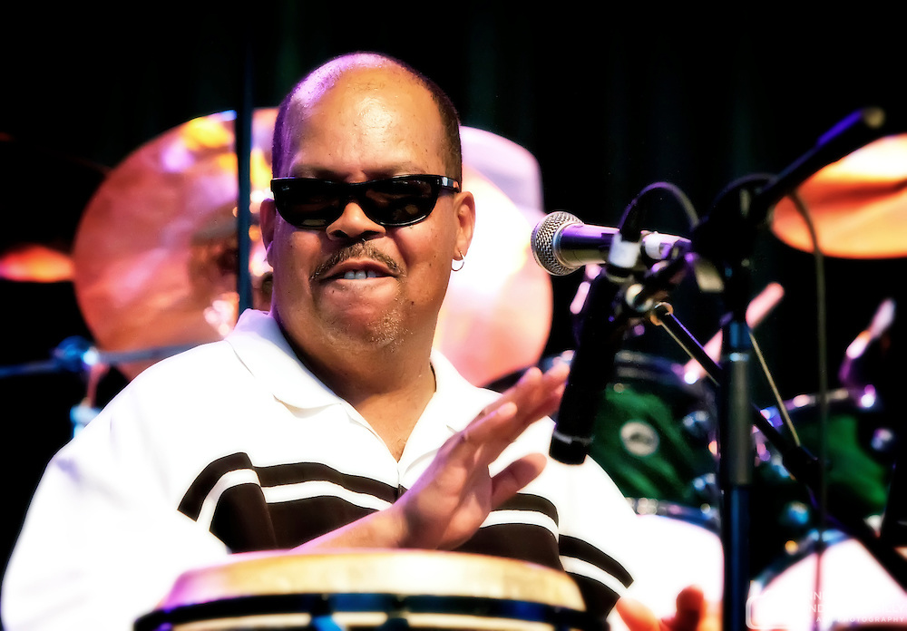 Mckinley Perkins III on percussion with Paul Cebar Tomorrow Sound performing live at Summerfest 2011. Photo © 2011 Jennifer Rondinelli Reilly. All rights reserved. No use without permission.  Contact me for any reuse or licensing inquiries.