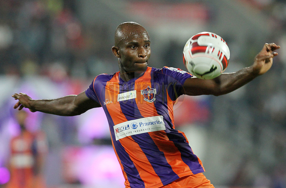 MacPherlin Dudu Omagbemi of FC Pune City in action during match 44 of the Hero Indian Super League between FC Pune City and Atletico de Kolkata FC held at the Shree Shiv Chhatrapati Sports Complex Stadium, Pune, India on the 29th November 2014.<br /> <br /> Photo by:  Vipin Pawar/ ISL/ SPORTZPICS