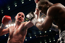 October 18, 2008; Atlantic City, NJ, USA;  Kelly Pavlik (navy trunks) and Bernard Hopkins (black trunks)trade punches during their 12 round Light Heavyweight fight at Boardwalk Hall in Atlantic City, NJ.  Hopkins won the fight via 12 round unanimous decision.