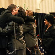 Wilmington Senior Firefighter daughter &quot;&quot;, carries her Mother&rsquo;s firefighter helmet accompanied by family members as they leave the Convention center after the end of the funeral services Sat, Dec. 11, 2016, at The Chase Center On The River Front in Wilmington, Delaware. <br /> <br /> Wilmington Senior Firefighter Ardythe Hope died Dec. 1 from injuries suffered battling a fire on September 24th that was ruled arson.  <br /> <br /> She'd been in the hospital ever since with burns over 70 percent of her body.