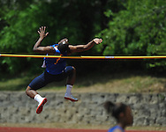 Oxford High's Justin Fondren high jumps at a high school track meet in Oxford, Miss. on Saturday, April 23, 2011.