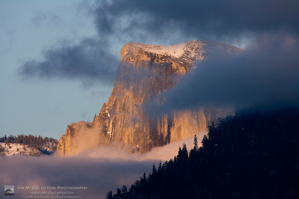 Clouds circle Half Dome at sunset - Yosemite National Park, California