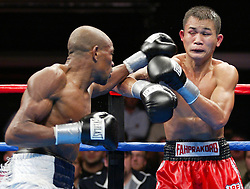 Valdemir Pereira (l) and Phafrakorb Rakkietgym (r) trade punches during their 12 round IBF Featherweight title fight at the Foxwoods Hotel and Casino.  Pereira captured the vacant title with a unanimous decision win