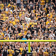 SHOT 9/1/13 7:01:13 PM - Colorado football fans cheer their team on while being framed by the goalposts against Colorado State during the 2013 Rocky Mountain Showdown at Sports Authority Field at MiIe HIgh Stadium in Denver, Co. Colorado won the annual in-state rivalry 41-27. (Photo by Marc Piscotty / © 2013)