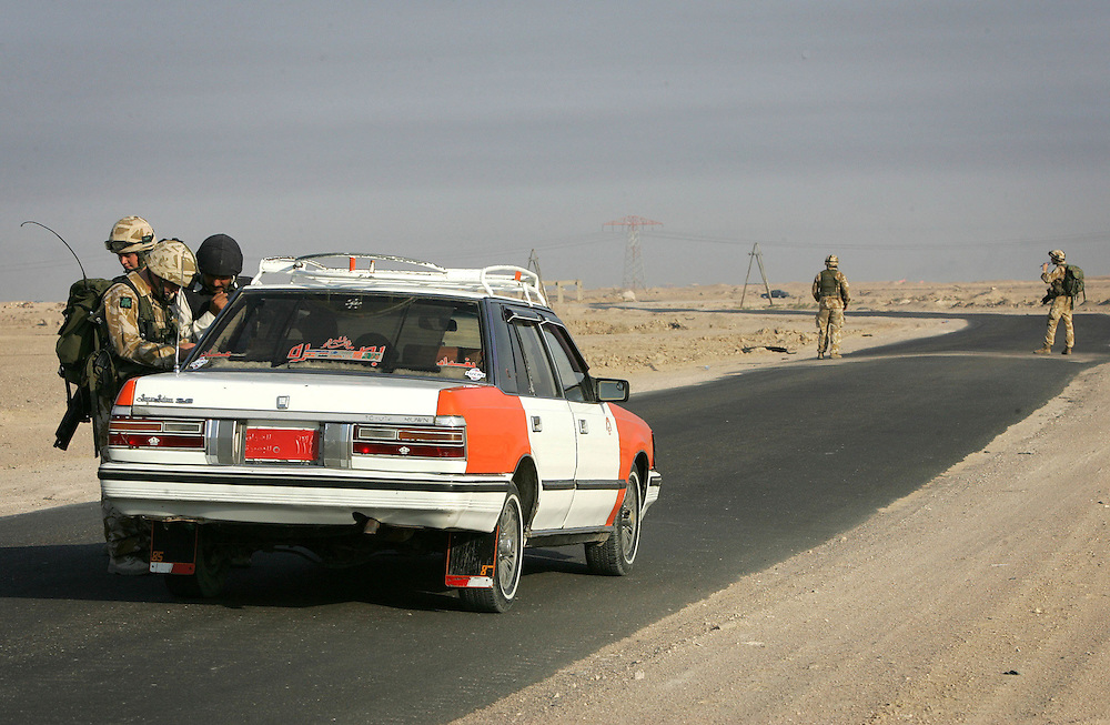 12 October 2005.Basra, Iraq..'Eagle VCP'..On 12 October 2005 days before Iraq's Referendum, soldiers of A Company 1st Royal Irish Regiment perform 'Eagle VCP's' on rural roads in the Basra area. The team is transported by Sea King helicopter from base to the roadway where the set up a vehichle checkpoint. They check drivers documents and search vehicles for weapons and explosives in their ongoing efforts to disrupt insurgent activity in the area.