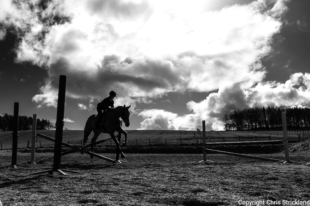 Ancrum, Jedburgh, Scottish Borders, UK. 27th March 2015. Four Star eventer Emily Galbraith schools a horse on a bright spring morning in the Borders.