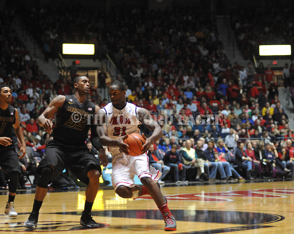 "Ole Miss' Murphy Holloway (31) vs. Missouri's Earnest Ross (33) at the C.M. ""Tad"" Smith Coliseum on Saturday, January 12, 2013. Ole Miss defeated #10 ranked Missouri 64-49."