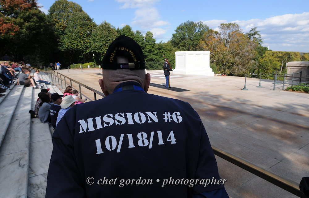 A WWII Veteran onboard the Hudson Valley Honor Flight views a sentinel at the Tomb of the Unknown Soldier in Arlington National Cemetery in Arlington, VA on Saturday, October 18, 2014. Seventy-five veterans from the Westchester County (NY) area toured the WWII Memorial and Arlington National Cemetery on the inaugural flight from Westchester County Airport in White Plains, NY. Hudson Valley Honor Flight is a chapter of the Honor Flight Network, which provides free flights for WWII Veterans and tours of the WWII Memorial constructed in their honor, and other sites in the nation's capital.  © www.chetgordon.com