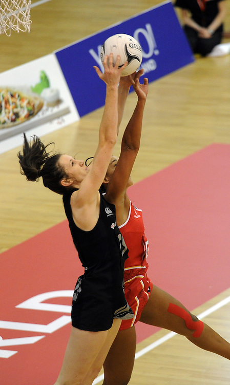New Zealand's Bailey Mes, left and England's Geva Mentor contest the ball in the 2nd International Netball test, Arena Manawatu, Palmerton North, New Zealand, Friday, October 31, 2014. Credit:SNPA / Ross Setford
