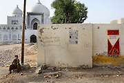 Celebrated young pakistani artist Asim Butt on a journey of political graffiti through Pakistan during the summer of 2009..By the Bhutto family tomb in the village of Garhi Khuda Buxbhutto Asim makes work titled 'Kills Kings'.