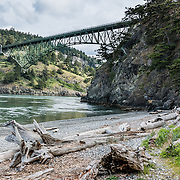 State Route 20 crosses a scenic bridge 180 feet above Deception Pass, a strait of water separating Whidbey Island from Fidalgo Island. North Beach (shown here) is a short walk from parking lots. Deception Pass connects Skagit Bay (part of Puget Sound) with the Strait of Juan de Fuca, which are all part of the Salish Sea. Deception Pass is the most-visited State Park in Washington.