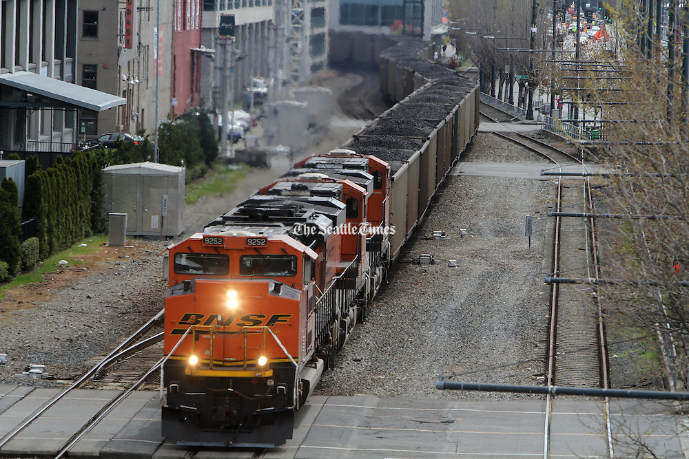 A coal train approaches SAM's Olympic Sculpture Park in Seattle. (Ken Lambert / The Seattle Times)