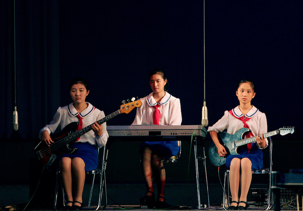 Young North Korean girls play a tune for the audience on their electric guitars and keyboard at the School Children's palace theater in Pyongyang, North Korea Tuesday Aug. 7, 2007.
