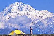 Alaska. Petersville. Woman and Child camping with incredible views of Mt McKinley.