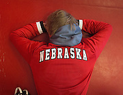 Husker wrestler Aaron Studebaker rests before the duel against Iowa at the Bob Devaney Sports Center in Lincoln, Neb., on Jan. 24, 2016. Iowa defeated Nebraska.