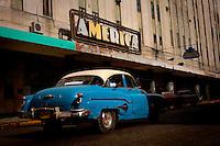 Vintage blue American car in Havana Cuba outside of hotel.