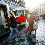 "SHOT 11/23/08 4:05:49 AM - Commuters make their way on and off of trams in the Malá Strana section of Prague, both meaning in English literally ""Little Side"", though more frequently referred to as ""Lesser Town"", ""Lesser Quarter"", or ""Lesser Side"") was originally a popular and nowadays also the official name for the former Men?í m?sto pra?ské (""The Lesser Town of Prague""), one of Prague's historical and oldest boroughs. Its name comes from its position on the left (west) bank of the river Vltava, on the slopes just below the Prague Castle, in opposition to the larger towns of Prague on the right bank, to which it is conjoined by the Charles Bridge. In the Middle Ages, it was a dominant centre of the ethnic German citizens of Prague. It also housed a large number of noble palaces while the right-bank towns were comparatively more bourgeois and more Bohemian Czech. Prague is the capital and largest city of the Czech Republic. Its official name is Hlavní m?sto Praha, meaning Prague, the Capital City. Situated on the River Vltava in central Bohemia, Prague has been the political, cultural, and economic centre of the Czech state for over 1100 years. The city proper is home to more than 1.2 million people, while its metropolitan area is estimated to have a population of over 1.9 million. Since 1992, the extensive historic centre of Prague has been included in the UNESCO list of World Heritage Sites. According to Guinness World Records, Prague Castle is the largest ancient castle in the world. Nicknames for Prague have included ""the mother of cities"", ""city of a hundred spires"" and ""the golden city"". Since the fall of the Iron Curtain, Prague has become one of Europe's (and the world's) most popular tourist destinations. It is the sixth most-visited European city after London, Paris, Rome, Madrid and Berlin. Prague suffered considerably less damage during World War II than some other major cities in the region, allowing most of its historic architecture to stay true to form"