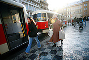 """SHOT 11/23/08 4:05:49 AM - Commuters make their way on and off of trams in the Malá Strana section of Prague, both meaning in English literally """"Little Side"""", though more frequently referred to as """"Lesser Town"""", """"Lesser Quarter"""", or """"Lesser Side"""") was originally a popular and nowadays also the official name for the former Men?í m?sto pra?ské (""""The Lesser Town of Prague""""), one of Prague's historical and oldest boroughs. Its name comes from its position on the left (west) bank of the river Vltava, on the slopes just below the Prague Castle, in opposition to the larger towns of Prague on the right bank, to which it is conjoined by the Charles Bridge. In the Middle Ages, it was a dominant centre of the ethnic German citizens of Prague. It also housed a large number of noble palaces while the right-bank towns were comparatively more bourgeois and more Bohemian Czech. Prague is the capital and largest city of the Czech Republic. Its official name is Hlavní m?sto Praha, meaning Prague, the Capital City. Situated on the River Vltava in central Bohemia, Prague has been the political, cultural, and economic centre of the Czech state for over 1100 years. The city proper is home to more than 1.2 million people, while its metropolitan area is estimated to have a population of over 1.9 million. Since 1992, the extensive historic centre of Prague has been included in the UNESCO list of World Heritage Sites. According to Guinness World Records, Prague Castle is the largest ancient castle in the world. Nicknames for Prague have included """"the mother of cities"""", """"city of a hundred spires"""" and """"the golden city"""". Since the fall of the Iron Curtain, Prague has become one of Europe's (and the world's) most popular tourist destinations. It is the sixth most-visited European city after London, Paris, Rome, Madrid and Berlin. Prague suffered considerably less damage during World War II than some other major cities in the region, allowing most of its historic architecture to stay true to form"""