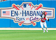 HAVANA, CUBA - MARCH 22, 2016: Roel Santos #1 of the Cuban National Team makes a catch in centerfield during the game against the Tampa Bay Rays at Estadio Latinoamericano on March 22, 2016 in Havana, Cuba. (Photo by Jean Fruth)