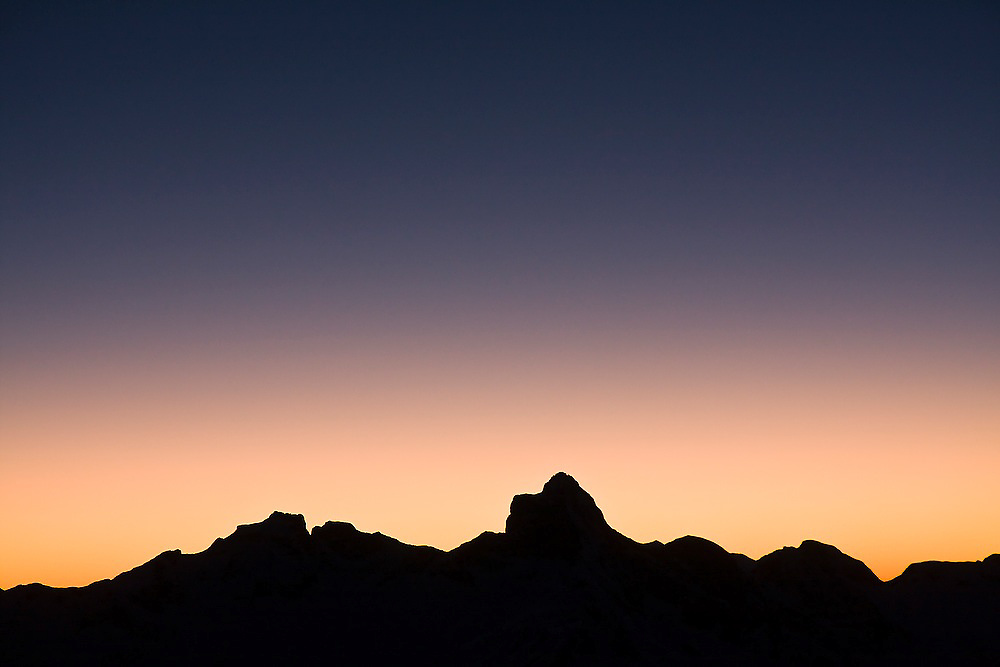 Silhouette of mountains at sunset in North Cascades National Park, Washington.