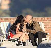 """July 23rd 2010  Los Angeles, CA.  ***EXCLUSIVE*** Megan Fox and Dominic Monaghan share some Vodka and a passionate kiss while sitting on lawn chairs on the rooftop of a Liquor store in a gritty  Los Angeles neighborhood. Fox and Monaghan spent the day filming scenes together for their starring roles in Eminem and Rihanna's music video for """"The Way You Lie"""". An injury of some kind is visible on Megan's elbow which is probably fake and for her character. Megan and Dominic also filmed a scene inside the liquor store as well as inside a seedy dive bar next door. Photo by Eric Ford/ On Location News 818-613-3955"""