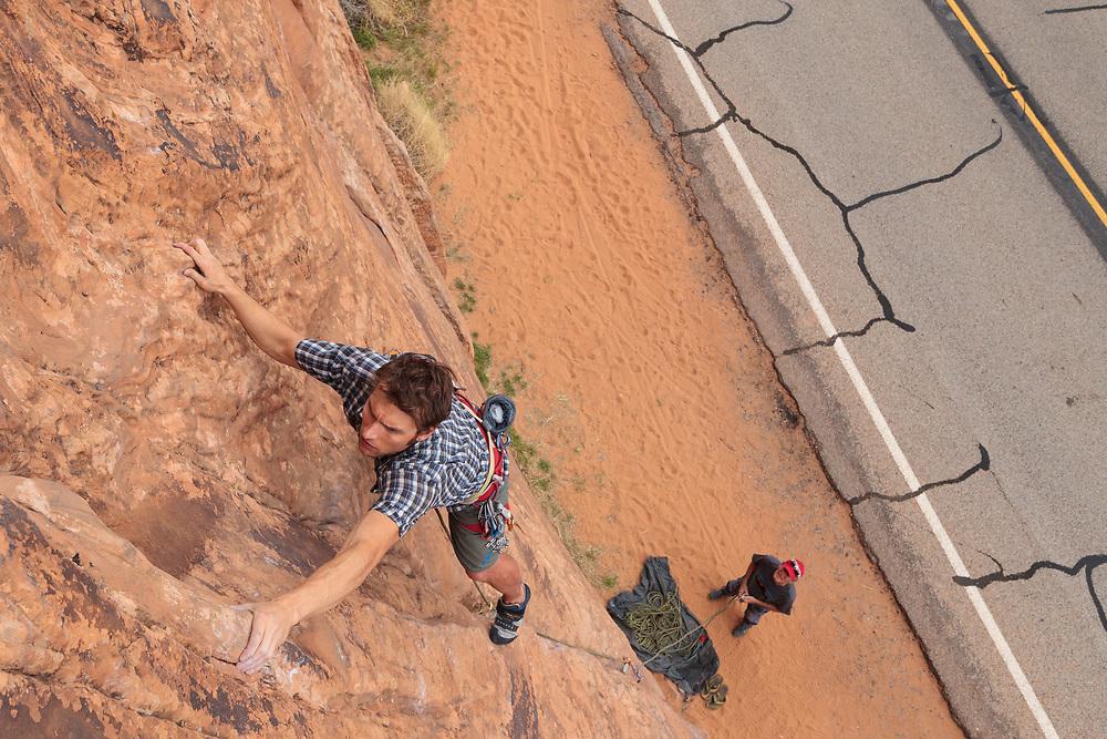 Pat Lindsay climbing at Wallstreet in Moab, UT