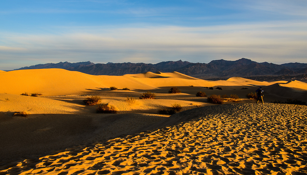 Eraly morning light on beautiful landscape. A lone photographer captures this moment. Mesquite Sand Dunes, Death Valley National Park, California