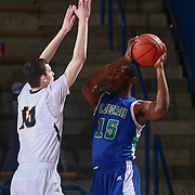 St. Georges Hawks Center VINCENT KENT (15) attempts to pass the ball as Sanford Warriors Center JACOB	WALSH (10) defends in the first half of a Boys Basketball DIAA State Tournament Finals match between the Sanford Warriors and the St. Georges Hawks Saturday, Mar. 12, 2016, at The Bob Carpenter Sports Convocation Center in Newark, DEL.