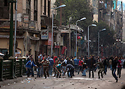 Stone throwing youths battle police in the Bulaq district during continuing January 26, 2011 demonstrations in downtown Cairo, Egypt. A series of unprecedented demonstrations have broken out across Egypt for the past two days, inspired by the revolution in Tunisia, and intended to spark a similar movement in Egypt. (Photo by Scott Nelson)