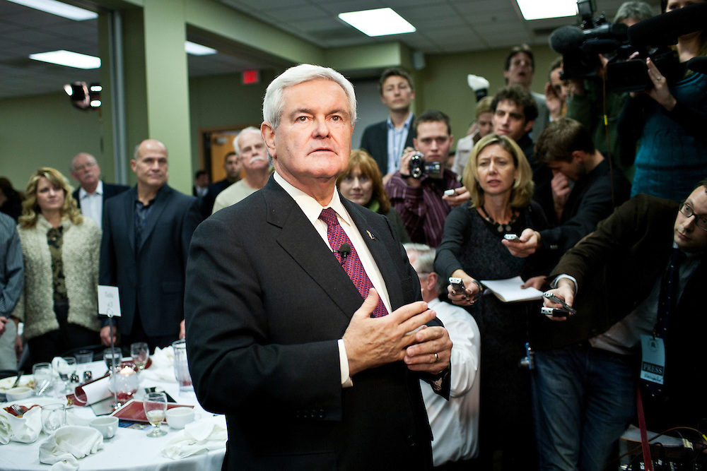 Republican presidential candidate Newt Gingrich speaks to reporters after addressing the Polk County Republican Party's Robb Kelley Victory Club dinner on Thursday, December 1, 2011 in Johnston, IA.