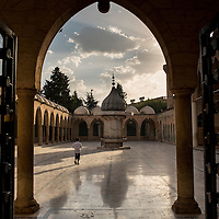Early morning at the Mevlid-I-Halil Mosque in Sanliurfa, Urfa, Turkey The Prophet Ibrahim is believed to have been born in a cave that is part of the Mosque.