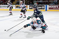 KELOWNA, CANADA - FEBRUARY 13: Mathew Barzal #13 of the Seattle Thunderbirds checks Nolan Foote #29 of the Kelowna Rockets to the ice during second period on February 13, 2017 at Prospera Place in Kelowna, British Columbia, Canada.  (Photo by Marissa Baecker/Shoot the Breeze)  *** Local Caption ***