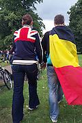 A British and a German fan walk hand in hand through Hyde Park in Central London