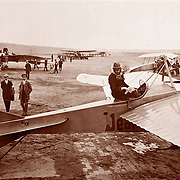 Civilian aviation, an early monoplane and pilot at an airport, circa 1912