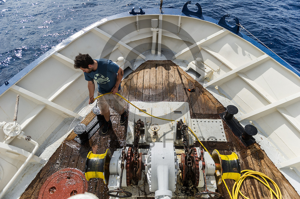 Der Sanitaeter Yannik Buchloh reinigt am 21.09.2016 das Verdeck des Fluechtlingsrettungsboot Sea-Watch 2 an der Kueste vor Lampedusa, Italien. Foto: Markus Heine / heineimaging<br /> <br /> ------------------------------<br /> <br /> Veroeffentlichung nur mit Fotografennennung, sowie gegen Honorar und Belegexemplar.<br /> <br /> Publication only with photographers nomination and against payment and specimen copy.<br /> <br /> Bankverbindung:<br /> IBAN: DE65660908000004437497<br /> BIC CODE: GENODE61BBB<br /> Badische Beamten Bank Karlsruhe<br /> <br /> USt-IdNr: DE291853306<br /> <br /> Please note:<br /> All rights reserved! Don't publish without copyright!<br /> <br /> Stand: 09.2016<br /> <br /> ------------------------------