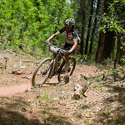 "Solo Male Champion David ""Tinker"" Juarez rips on the Broken Nose Trail during the USA Cycling 24-Hour Mountain Bike National Championships in McGaffey New Mexico Saturday."