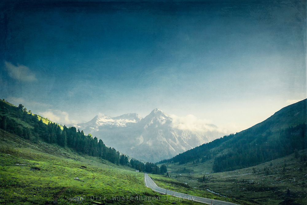 Road leading to Splügen Pass, Switzerland. Texturized photograph.