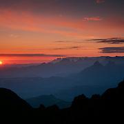 Drakensberg escarpment sunrise from Ntaba Ndanyazana 3084m, Ifidi.  Middle distance: Mnweni Needles, far distance: Cathedral and Cathkin ridges, Ukahlamba-Drakensberg Park, KwaZulu-Natal, South Africa. Nikon F90, 35-135/3.5. E100SW. December 1996.