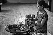 Myanmar.  Lady rolling cheroots.