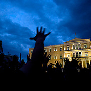 Tens of thousands of people gather around Syntagma (constitution) square. People are protesting against the Government's handling of the economic crisis in Athens, Greece. Image © Angelos Giotopoulos/Falcon Photo Agency