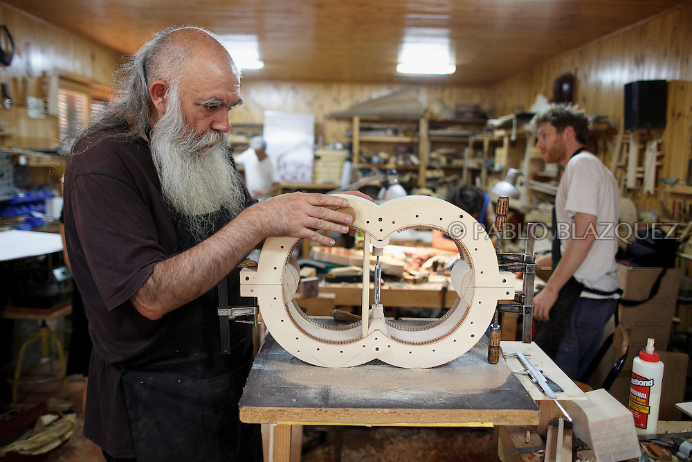 10/08/2016. Luthier Jesus Reolid works on organistrum in a workshop on August 10, 2016 in Pelayos de la Presa, Madrid province, Spain. The Collegiate of Santa María la Mayor is a Romanesque architecture church built during the 12th and 13th centuries. Recents restorations of the Church discovered many details on its sculptures, and luthiers found the opportunity of recovering and to reproduce instruments showing on its North gate. (© Pablo Blazquez)