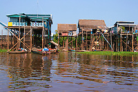 Kampong Khleang Stilt Houses - The Tonle Sap is a combined lake and river system of huge importance to Cambodia.The area is home to many ethnic Vietnamese and numerous Cham communities living in floating villages around the lake. The Tonle Sap is the largest freshwater lake in Southeast Asia and is an ecological hot spot that was designated as a UNESCO biosphere in 1997.  For most of the year the lake is fairly small, around one meter deep and with an area of 2,700 square km. During the monsoon season, however, the Tonlé Sap river, which connects the lake with the Mekong river, reverses its flow. Water is pushed up from the Mekong into the lake, increasing its area to 16,000 square km and its depth to up to nine meters, flooding nearby fields and forests. The floodplain provides a perfect breeding ground for fish.