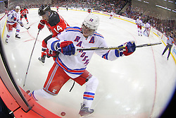 Oct 21, 2014; Newark, NJ, USA; New York Rangers defenseman Marc Staal (18) and New Jersey Devils center Adam Henrique (14) battle for the puck along the boards during the second period at Prudential Center.