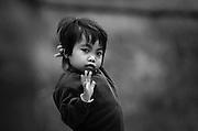 A Khamu girl says goodbye near Luang Prabang, Laos.