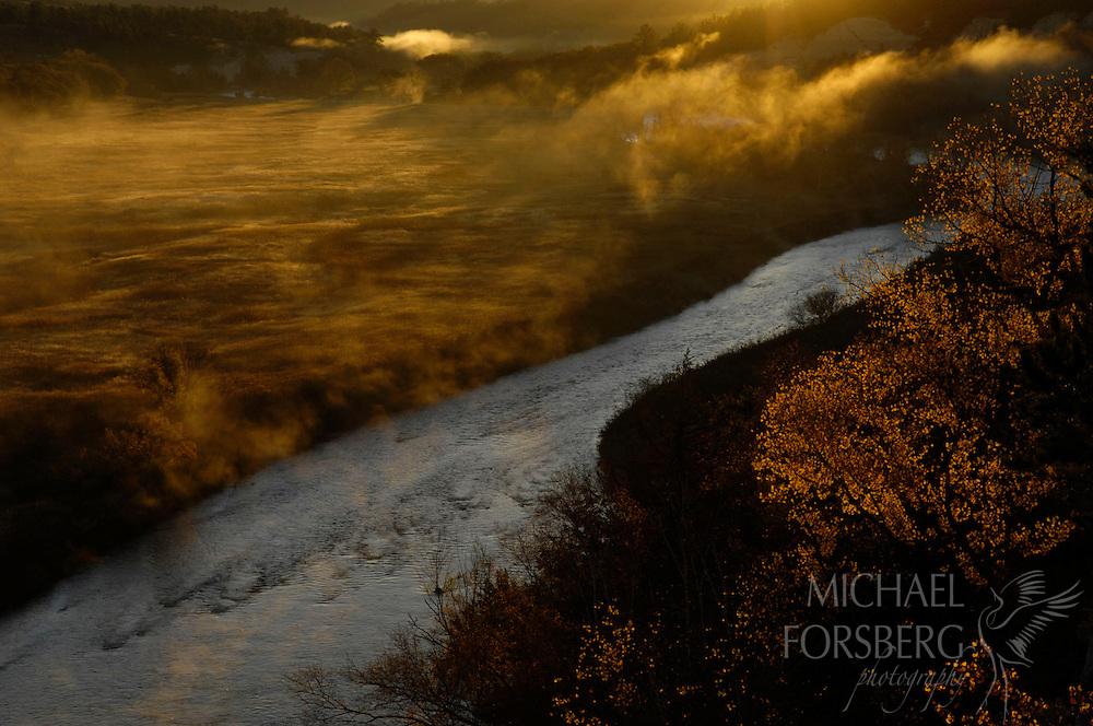 "Morning fog gathers along the Niobrara River, considered a ""biological crossroads"" of the Great Plains.  Nebraska."