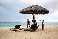 Woman and boy at Playa Maguana, Guantanamo, Cuba.