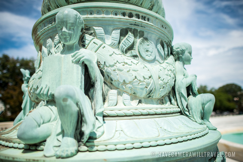 Supreme Court Flag Pole Sculpture. Decorative sculptures of cherubs depicting symbolism related to justice on the  base of one of the flagpoles standing in the plaza in front of the Supreme Court of the United States building on Capitol Hill.